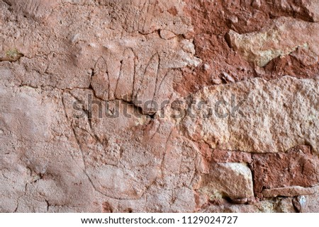 USA, Colorado, Montezuma County, Canyons of the Ancients National Monument. A Six Fingered Hand Etching in Plaster on the side of a pueblo. #1129024727