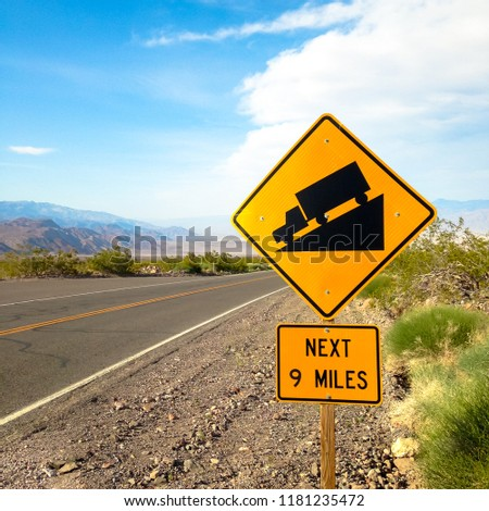 USA. Death valley. Sign at the road steep descent.