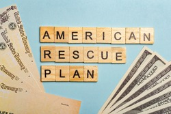 USA dollars background. American rescue plan, USA relief program, stimulus check and Act of 2021 concept. Money, business, profit and livelihood idea