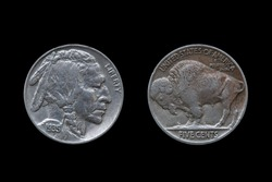 USA five cents Buffalo Indian Head nickel coin dated 1935 front and back (obverse and reverse) cut out and isolated on a black background, stock photo image
