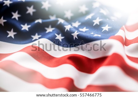 Shutterstock USA flag. American flag. American flag blowing wind. Close-up. Studio shot.