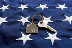 USA flag and key from home as symbol of VA loan.