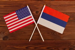 USA flag and Russia flag crossed with each other. USA vs Russia. Meeting between the presidents of the United States and Russia. Tensions in relations between the countries are growing