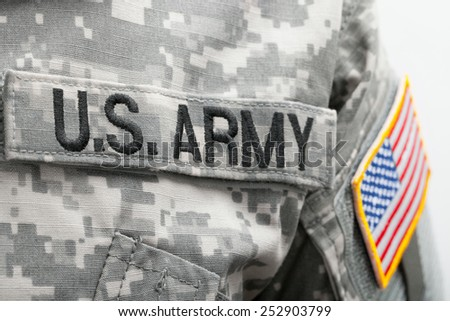 USA flag and US Army patch on solder's uniform