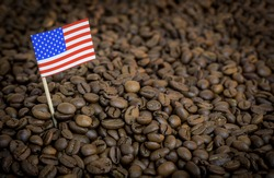 USA flag country sticking in roasted coffee beans.