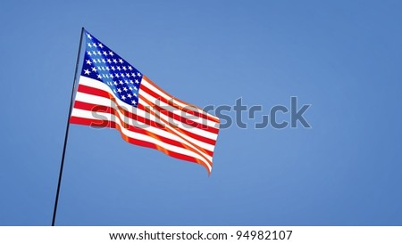 USA flag in the clear blue sky