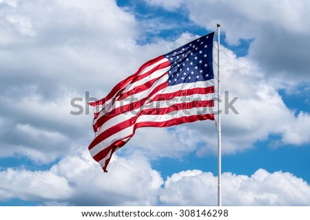 Usa flag in the wind stock photo #308146298