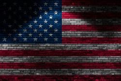USA flag on brick wall at night