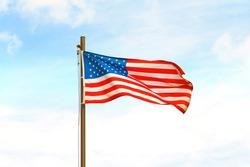 USA flag on flagpole on sky background.