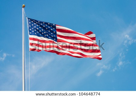 USA Flag on pole waving in the wind
