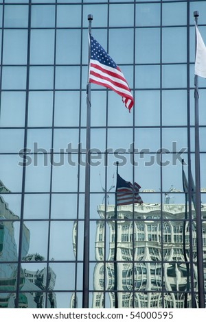 USA flag reflected in glass building