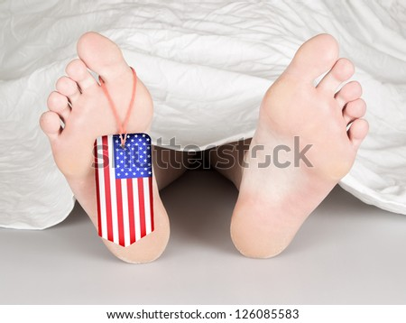 USA flag tag on the foot of a body