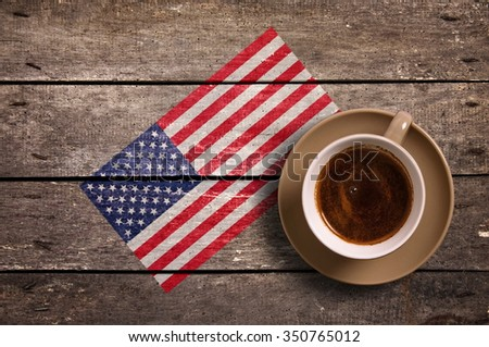 USA flag with coffee on table. top view
