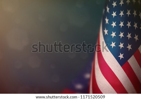 USA hanging flag for honour of veterans day or memorial day on light blue dark velvet background. USA glory to the heroes of war concept. #1171520509