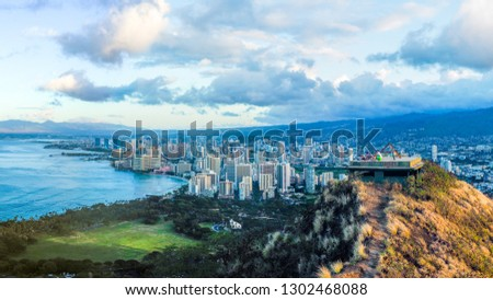 USA, HAWAII - SEPTEMBER 2, 2018: People on roof of the old lookout points on the summit of Diamond Head looking out at the view of Honolulu #1302468088