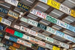 USA, Maine, Wells. Antique license plates.