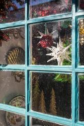 USA, Massachusetts, Nantucket Island. Nantucket Town, Christmas decorations in window.