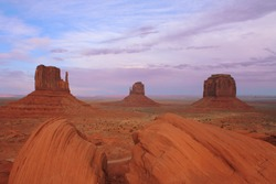 USA, Monument Valley with three butes and rock in foreground