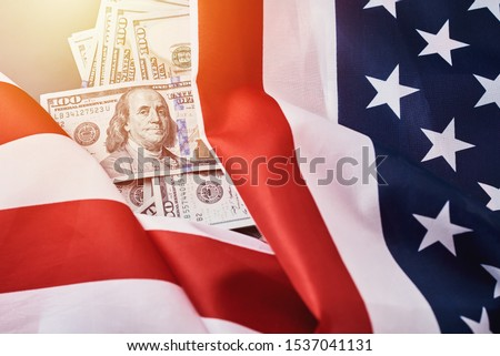 USA national flag and currency usd money banknotes. Business and finance concept