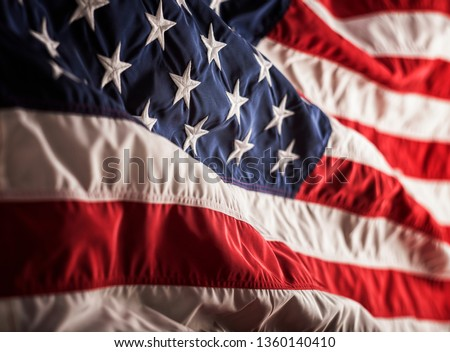 USA National Flag wrinkled cloth nylon embroidered stars sewn stripes closeup studio shot