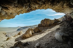 USA, Nevada, Churchill County, Lahontan Mountains, Grimes Point Archelogical Site. A view looking towards Hidden Cave entrance from inside Picnic Cave (Rockshelter).