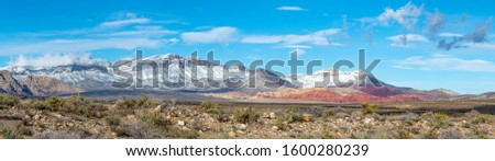 USA, Nevada, Clark County, Red Rock Canyon National Conservation Area. A panoroama of Snow covering the mountains above this famous hiking area outside Las Vegas Stock photo ©