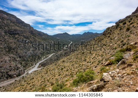 USA, Nevada, Clark County, Red Rock Canyon National Conservation Area. The Pahrump Valley Highway (State Route 160) snakes its way up towards the pass to Mountain Springs.