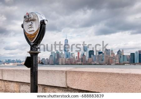 Shutterstock USA, New Jersey, View on Manhattan skyline from Ellis Island, Binoculars in foreground