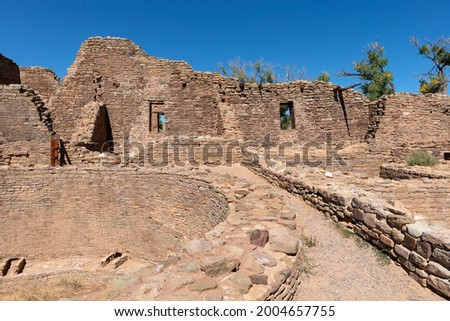 USA, New Mexico. Aztec Ruins National Monument, Kiva and stonewall masonry structure at West Ruin, originally built by ancestral Pueblo people. Stock photo ©