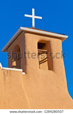 USA, New Mexico, Taos. Top of San Francisco de Asis adobe church in early morning sun. Rancho de Taos Credit as: Fred Lord / Jaynes Gallery /DanitaDelimont.com