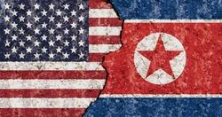 USA North Korea flag cracked wall background
