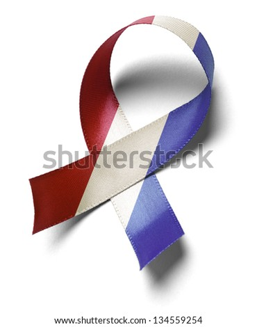 USA red white and blue ribbon support isolated on a white background.