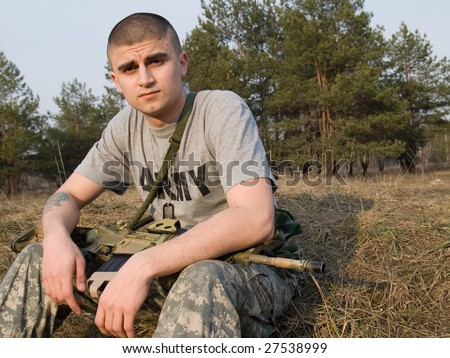 USA Soldier having rest on the grass at the end of the day after a hard training or combat