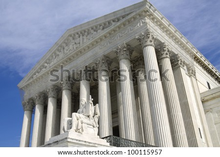 USA Supreme Court building in Washington, D.C. with a blue cloudy sky background.