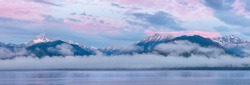 USA, Washington State, Seabeck. Composite of Hood Canal and Olympic Mountains at sunrise.