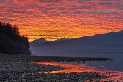 USA, Washington State, Seabeck. Sunset on Hood Canal and Olympic Mountains.