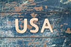 USA written with wooden letters on rustic surface
