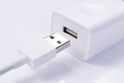 usb cable with usb wall charger plug isolated on a white