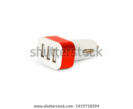 USB car charger in cigarette lighter isolated on a white background. Clipping Path. #1419718394