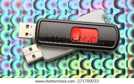 Usb flash drives on the abstract background