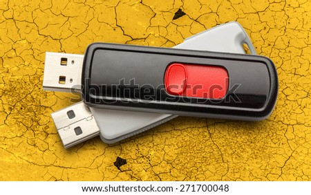 Usb flash drives on the cracked background