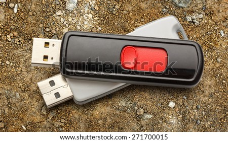 Usb flash drives on the ground background