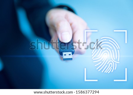 USB Key Lock Access with Fingerprint Biometrics Scanner for future data security technology concept.