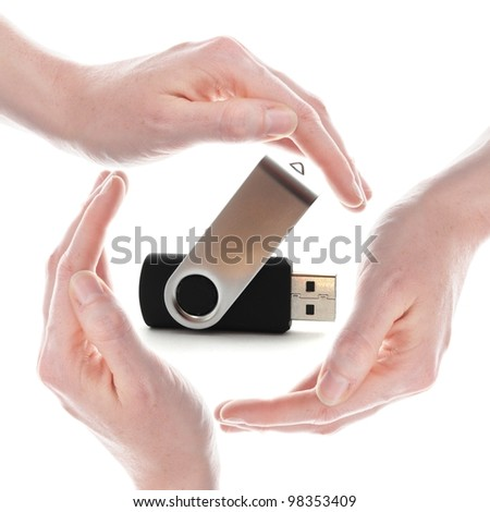 usb stick or flash drive with hands isolated on white background