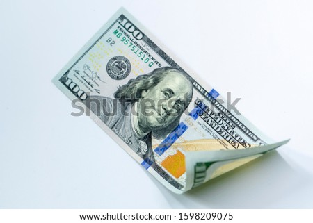 USD 100 dollars banknotes on isolated white background, Money currency of United States (USA), USD Dollar Bank note pile, Business and finance concept.
