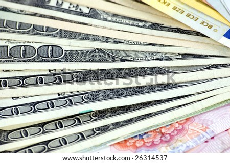 USD, Euro and RMB setup in fan shape. Photo of different banknotes, money in different shapes and colors. Useful for financial, economic backgrounds.