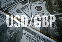 Usd/gbp sign text over dollars banknote  background