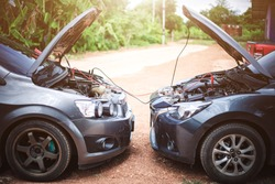 Use new car battery to start the engine of the vehicle using cables,Trying to jump start a car's.safely jump start a dead battery concept.
