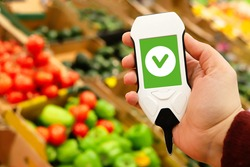 Use nitrate tester in market to buy organic vegetables and fruits. Inspection of farm products to high content of nitrates and nitrites. concept of health care and proper nutrition.