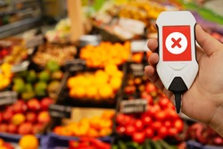 Use nitrate tester in market to buy organic vegetables and fruits. Inspection of farm products to high content of nitrates and pesticides. Dangerous excess of indicators. concept of proper nutrition.